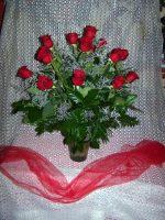 dozen vased roses 75.00